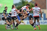 Adam Hastings of Bath Rugby puts in a big tackle. West Country Challenge Cup match, between Gloucester Rugby and Bath Rugby on September 13, 2015 at the Memorial Stadium in Bristol, England. Photo by: Patrick Khachfe / Onside Images