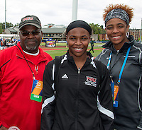 Coach Vince Bingham, freshman Claudette Day, and Coach Connie Teaberry pose for a photo at the 2014 NCAA Division I Outdoor Track and Field Championships at Hayward Field, in Eugene, Or. Day who graduated high school early to enroll at Northern Illinois University in January, qualified for the national championships in the high jump, a week after she rejoined her high school class at the official graduation ceremony in May. Day was one of four women in the field of 24 in Eugene unable to clear the opening height of 5-7.75.