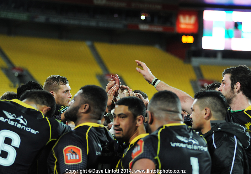 The Lions huddle after the ITM Cup rugby union match between Wellington Lions and Waikato at Westpac Stadium, Wellington, New Zealand on Saturday, 16 August 2014. Photo: Dave Lintott / lintottphoto.co.nz