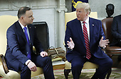 US President Donald J. Trump (R), with Polish President Andrzej Duda (L), delivers remarks during a meeting in the Oval Office of the White House in Washington, DC, USA, 12 June 2019. Later in the day President Trump and President Duda will participate in a signing ceremony to increase military to military cooperation including the purchase of F-35 fighter jets and an increased US troop presence in Poland. <br /> Credit: Shawn Thew / Pool via CNP