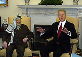 United States President Clinton meets with Yasser Arafat, Chairman of the Palestinian Authority, in the Oval Office of the White House in Washington DC. on Thursday, January 20,  2000.  Arafat arrived in Washington on Thursday for a meeting with President Clinton, complaining his peace moves with Israel were going nowhere.   .Credit: Mark Wilson - Pool via CNP