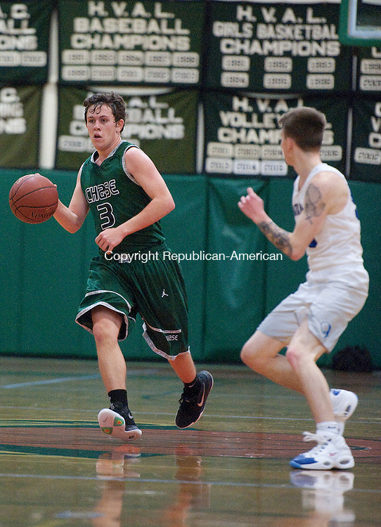 WATERBURY,   CT-012817JS02- Chase's  Robby Jones (3) brings the ball up court while being guarded by Watkinson's Cain Schneider  (55) during their game Saturday at the Goss Field House on the Chase Collegiate campus in Waterbury.<br /> Jim Shannon Republican-American