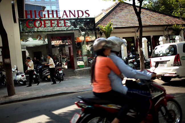 Traffic drives by Highlands Coffee in Ho Chi Minh City...Kevin German / LUCEO