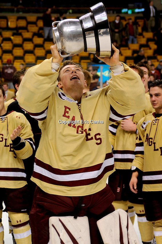 Boston College goaltender Brad Barone (29) hoists the Beanpot trophy after winning the championship round of the Beanpot Tournament hockey between Boston College and Northeastern University held at TD Garden in Boston Massachusetts.  Eric Canha/CSM