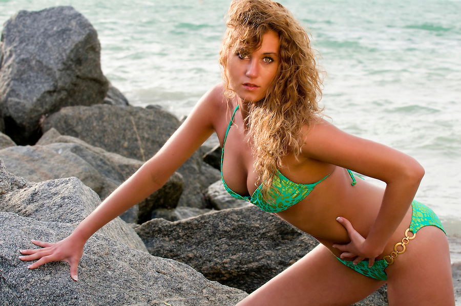 Very sensual caucasian woman enjoys the beach.