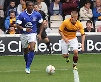 Sylvain Distin gets the better of Henrik Ojamaa in the Motherwell v Everton friendly match at Fir Park, Motherwell on 21.7.12 for Steven Hammell's Testimonial.