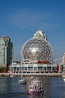 Aquabus ferry on False Creek with Science World dome in back,  Vancouver, BC, Canada