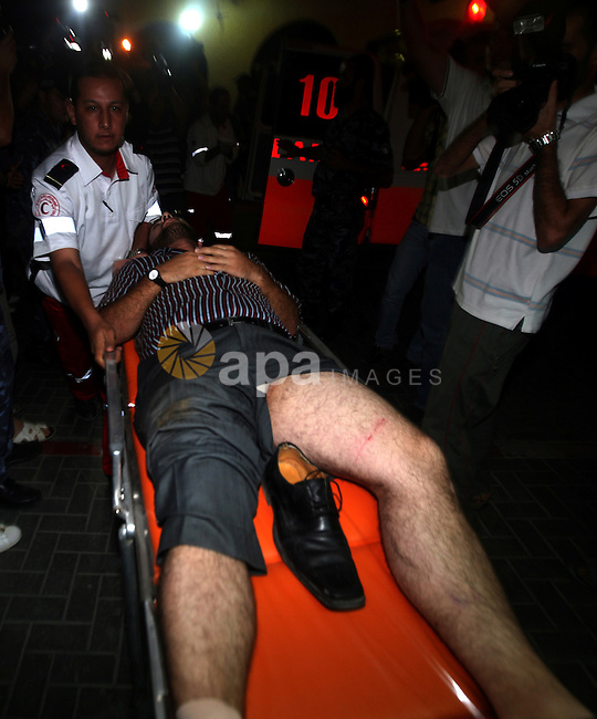 Palestinians transport an injured man to Al-Shifa hospital, after an overnight Israeli air strike, in Gaza City August 19, 2011. Israeli aircraft struck Hamas security installations in Gaza on Friday, killing at least one Palestinian, in further retaliation for attacks along the Egyptian border in which eight Israelis die. Photo by Ali Jadallah