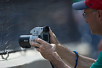 A fan takes photos using an older model digital camera during the International League game between the Scranton/Wilkes-Barre RailRiders and the Gwinnett Stripers at Coolray Field on August 18, 2019 in Lawrenceville, Georgia. The RailRiders defeated the Stripers 9-3. (Brian Westerholt/Four Seam Images)