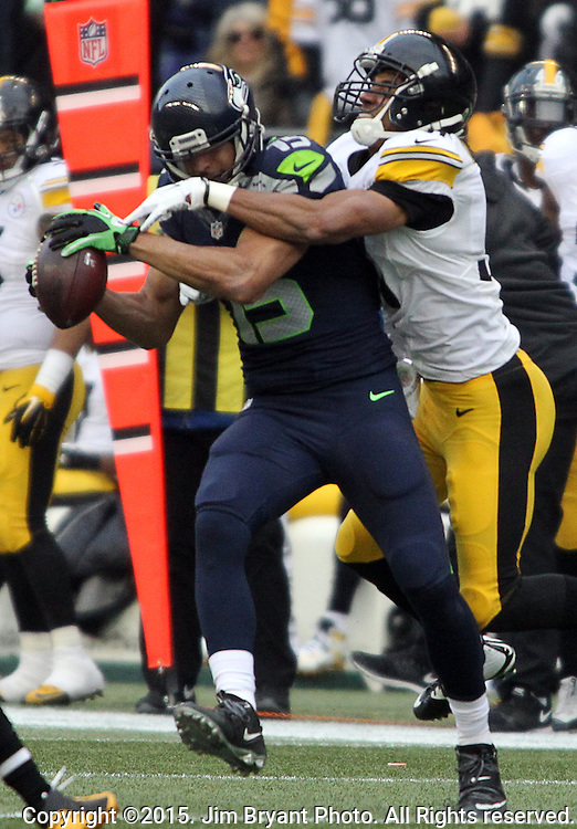Seattle Seahawks wide receiver Jermaine Kearse (15) catches a pass for a first down against Pittsburgh Steelers cornerback Ross Cockrell (31) at CenturyLink Field in Seattle, Washington on November 29, 2015.  The Seahawks beat the Steelers 39-30.      ©2015. Jim Bryant Photo. All Rights Reserved.