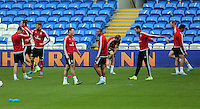 CARDIFF, WALES - SEPTEMBER 05: Team captain Ashley Williams (C) shares a joke with James Chester during the Wales training session, ahead of the UEFA Euro 2016 qualifier against Israel, at the Cardiff City Stadium on September 5, 2015 in Cardiff, Wales.