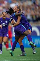 Orlando, FL - Sunday June 26, 2016: Jasmyne Spencer celebrates scoring, Dani Weatherholt  during a regular season National Women's Soccer League (NWSL) match between the Orlando Pride and the Portland Thorns FC at Camping World Stadium.