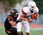 SIOUX FALLS, SD - AUGUST  28: Isaiah Blok #88 from Brandon Valley is wrapped up by Jack Bren #6 from Washington in the first half of their game Friday night at Howard Wood Field. (Photo by Dave Eggen/Inertia)