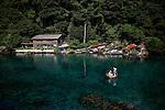 Sado Island, August 2010 - Tourists riding a TaraiBune in Yajima Kyojima, kind of tub boat used by fishermen in this part of the island.