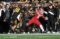 NWA Media/Michael Woods --11/28/2014-- w @NWAMICHAELW...University of Arkansas running back Alex Collins is knocked out of bounds after a run in the 2nd quarter of Fridays game against Missouri at Faurot Field in Columbia Missouri.