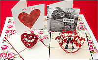 BNPS.co.uk (01202 558833)<br /> Pic: TomWren/BNPS<br /> <br /> The four cards that are avaliable to send to loved ones for Valentine's Day.<br /> <br /> A British village is cashing in on the cupid effect this Valentine's Day by launching its own postal service so anyone can send a card from the 'world's most romantic village'.<br /> <br /> The tiny village of Lover in Wiltshire has launched the 'Lover Post' with limited edition cards and a special post mark showing it has been sent from the tender-hearted village.<br /> <br /> The quirky gimmick is part of a campaign to save the once-thriving village for the local community.