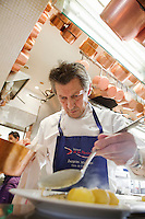 Chef Jacques Maximin adds the final touches to a dish in the kitchen of his restaurant Le Bistro de la Marine, Cagnes sur Mer, France, 07 April 2012