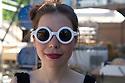 Designer wearing sunglasses at Fuorisalone in Ventura street, Milano April 14, 2016. &copy; Carlo Cerchioli<br /> <br /> Designer con occhiali da sole al Fuorisalone in via Ventura, Milno 14 aprile.