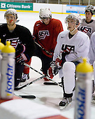 Kevin Shattenkirk (US White - 14), James vanRiemsdyk (US White - 21), Vinny Saponari (US White - 20), Jeremy Smith (US White - 1) - US players take part in practice on Friday morning, August 8, 2008, in the NHL Rink during the 2008 US National Junior Evaluation Camp and Summer Hockey Challenge in Lake Placid, New York.