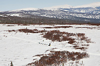 Aerial view of Jim Lanier as he does the uphill climb into the Blueberry Hills between Unalakleet and Shaktoolik in Arctic Alaska during the 2010 Iditarod