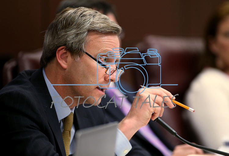 Nevada Sen. Greg Brower, R-Reno, works in committee at the Legislative Building in Carson City, Nev., on Wednesday, May 6, 2015.<br /> Photo by Cathleen Allison