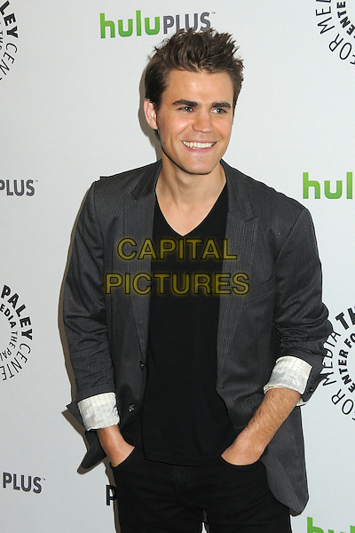"Paul Wesley.PaleyFest 2012 Presents ""The Vampire Diaries"" held at the Saban Theatre. Beverly Hills, California, USA, .10th March 2012.half length jacket blazer trousers hands in pockets  grey gray black v-neck .CAP/ADM/BP.©Byron Purvis/AdMedia/Capital Pictures."