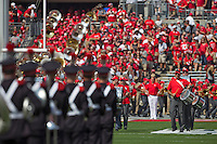 The Ohio State Alumni Band marches into Ohio Stadium in front of the current marching band prior to the NCAA football game at Ohio Stadium in Columbus on Sept. 7, 2013. (Alex Holt / The Columbus Dispatch)