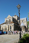 Tourists outside Romsey Abbey, Romsey, Hampshire, England