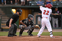 Home plate umpire Patrick Sharshel, Kane County Cougars catcher Will Remillard (20) and second baseman Richy Pedroza (22) during a game against the Peoria Chiefs on June 2, 2014 at Dozer Park in Peoria, Illinois.  Peoria defeated Kane County 5-3.  (Mike Janes/Four Seam Images)