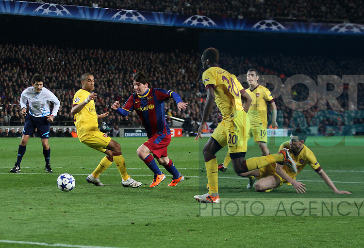 Barcelonas Lionel Messi runs through the Arsenal defence