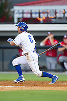 Jose Martinez (6) of the Burlington Royals follows through on his swing against the Danville Braves at Burlington Athletic Park on July 5, 2014 in Burlington, North Carolina.  The Royals defeated the Braves 5-4.  (Brian Westerholt/Four Seam Images)