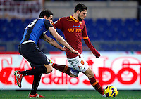 Calcio, semifinale di andata di Coppa Italia: Roma vs Inter. Roma, stadio Olimpico, 23 gennaio 2013..AS Roma forward Mattia Destro is chased by FC Inter defender Andrea Ranocchia, left, during the Italy Cup football semifinal first half match between AS Roma and FC Inter at Rome's Olympic stadium, 23 January 2013..UPDATE IMAGES PRESS/Isabella Bonotto