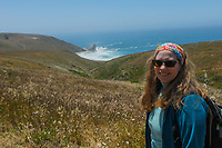 Lori stops along the Tomales Point Trail in Point Reyes National Seashore. McClures Beach is in the distance.