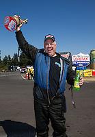 Aug. 4, 2013; Kent, WA, USA: NHRA top alcohol funny car driver Clint Thompson celebrates after winning the Northwest Nationals at Pacific Raceways. Mandatory Credit: Mark J. Rebilas-USA TODAY Sports