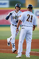 New Orleans Baby Cakes manager Keith Johnson (21) congratulates JT Riddle (17) as he rounds the bases after hitting a home run during a Pacific Coast League game against the Oklahoma City Dodgers on May 6, 2019 at Shrine on Airline in New Orleans, Louisiana.  New Orleans defeated Oklahoma City 4-0.  (Mike Janes/Four Seam Images)