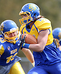 BROOKINGS, SD - APRIL 26:  Dom Wright #10 from South Dakota State's offense looks to get past Mark Pickerel #13 from the defense during their spring game Saturday at Coughlin Alumni Stadium in Brookings. (Photo by Dave Eggen/Inertia)