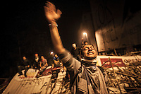 A protester chants slogans in a barricade at the streets nearby Taksim Square during a masive rally against the turkish government in Istanbul, Turkey.