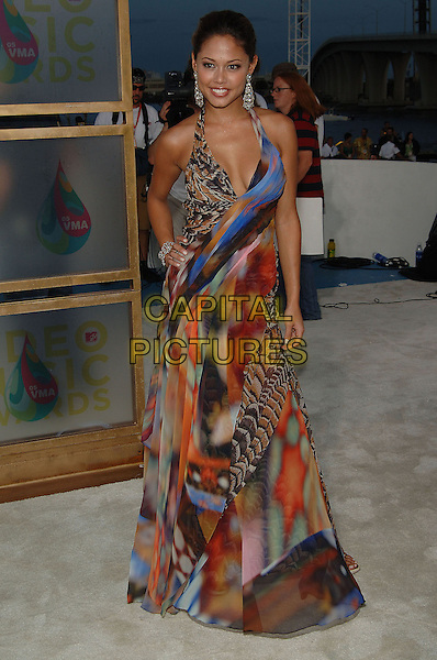 VANESSA MINNILLO.MTV Video Music Awards.Arrivals held at the American Airlines Arena,.Miami, 28th August 2005.full length multi colour color print pattern dress halter neck hand hip silver earrings.Ref: ADM/JW.www.capitalpictures.com.sales@capitalpictures.com.© Capital Pictures.v-neck plunging neckline