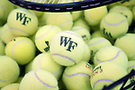 WINSTON-SALEM, NC - JANUARY 23: A basket of practice tennis balls. The Wake Forest University Demon Deacons hosted Coastal Carolina University on January 23, 2018 at Wake Forest Tennis Complex in Winston-Salem, NC in a Division I College Men's Tennis match. Wake Forest won the match 6-1.
