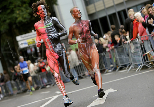 04th October 2009: Two runners with body paintings take part in the Cologne Marathon in Cologne, Germany. (Photo by Rolf Vennenbernd/ActionPlus). UK Licenses Only