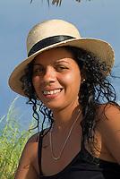 Portrait of a smiling young Cuban woman at the beach, Cayo Jutias, Cuba.