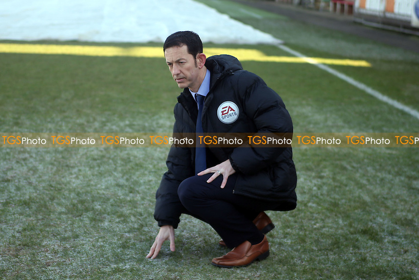 Match referee Dean Treleaven inspects the pitch before Dagenham & Redbridge vs Bromley, Vanarama National League Football at the Chigwell Construction Stadium on 21st January 2017