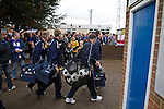 Wealdstone 0 Newport County 0, 17/03/2012. St Georges Stadium, FA Trophy Semi Final. Visiting players walking past rival supporters outside St Georges Stadium, home ground of Wealdstone FC, before the club played host to Newport County in the semi-final second leg of the F.A. Trophy. The game ended in a goalless draw, watched by a capacity crowd of 2,092 which meant the visitors from Wales progressed by three goals to one to the competition's final at Wembley, where they would meet York City. The F.A. Trophy was the premier cup competition for non-League clubs in England and Wales affiliated to the Football Association. Photo by Colin McPherson.
