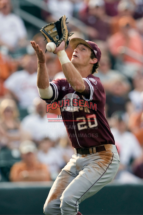Texas A&M Aggies third baseman Adam Smith #20 drops a pop up in the first inning against the Texas Longhorns in NCAA Big XII Conference baseball on May 21, 2011 at Disch Falk Field in Austin, Texas. (Photo by Andrew Woolley / Four Seam Images)
