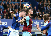 1st October 2017, Goodison Park, Liverpool, England; EPL Premier League Football, Everton versus Burnley; Stephen Ward of Burnley  wins a header in the penalty area as Michael Keane of Everton challenges