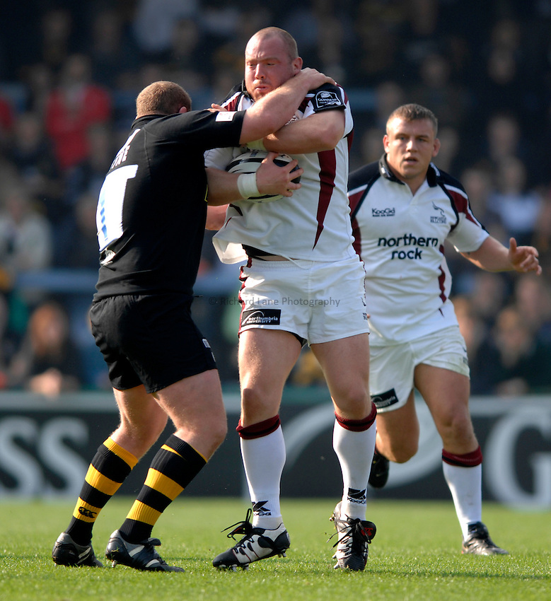 Photo: Richard Lane..London Wasps v Newcastle Falcons. Guinness Premiership. 15/10/2006. .Falcons' Robbie Morris is tackled by Tim Payne.