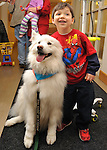 A patient and therapy dog at  at NYU Langone Medical Center, NYC.<br /> <br /> Photos for Making Headway Foundation