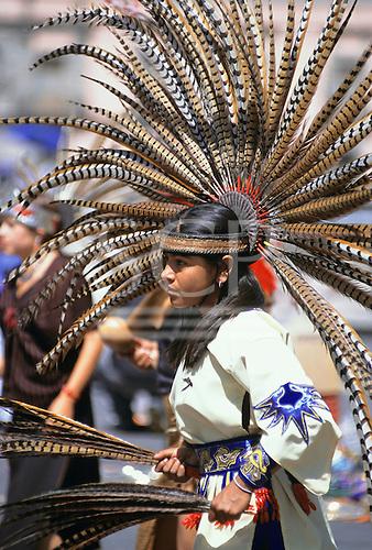 Mexico City. Traditional dancer in Aztec costume with feather headdress near the Templo Mayor, Zocalo Plaza de la Constitucion.