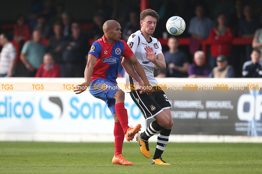 Elliott Romain of Dagenham and Redbridge and Jake Lawlor of Wrexham during Dagenham & Redbridge vs Wrexham, Vanarama National League Football at the Chigwell Construction Stadium on 13th October 2018