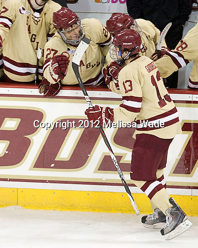 Quinn Smith (BC - 27), Johnny Gaudreau (BC - 13) - The Boston College Eagles defeated the visiting University of New Hampshire Wildcats 4-3 on Friday, January 27, 2012, in the first game of a back-to-back home and home at Kelley Rink/Conte Forum in Chestnut Hill, Massachusetts.